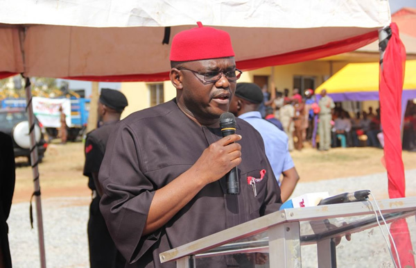 08 Honorable Minister of Health Prof Onyebuchi Chukwu delivers the Presidents address at the 2013 World AIDS Day