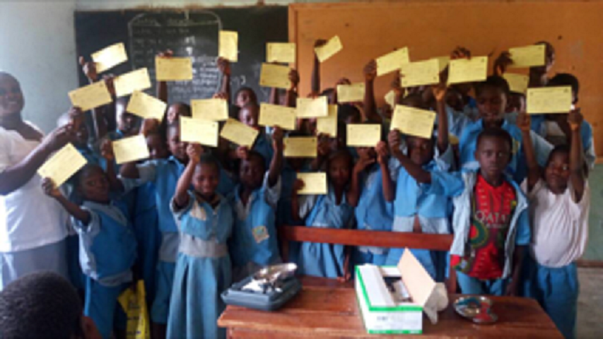 Primary school pupils of Eleyin in Isanlu, Isin LGA of Kwara state displaying their YF vaccination card