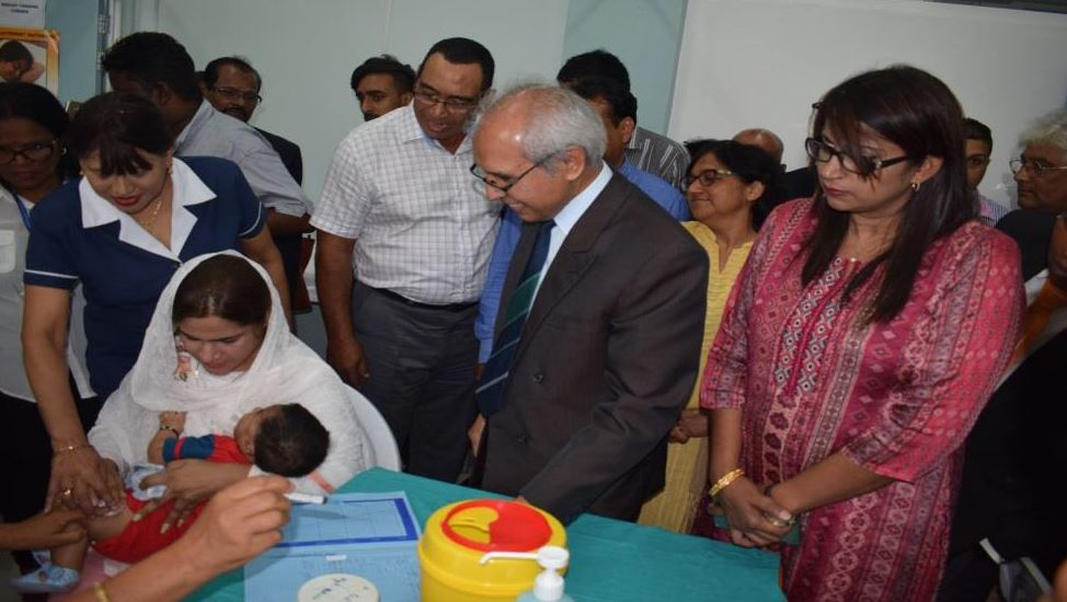 The first Mauritian baby receiving the Hexavalent vaccine in the presence of Dr A. Husnoo, Health Minister, Mrs R. Jadoo-Jaunbocus, Minister of Gender Equality, Child Development and Family Welfare and other eminent staff of the Ministry of Health and Quality of Life