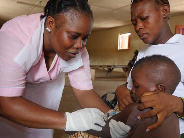 A nurse vaccinating a child