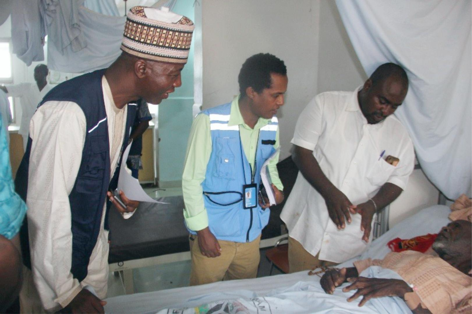 (L-R) Dr Hassan Bala (WHO), Hanibal Abiy OCHA/NHF focal person (and the Chief Nursing officer visiting a  beneficiary of the WHO/NHF fund at the Borno  State Specialist Hospital