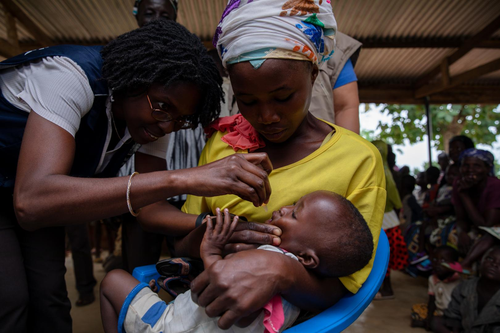 Dr Sally Ann Ohene, Disease Prevention and Control Officer in WCO dosing a child in Ando Nymadou, a community in Chereponi District