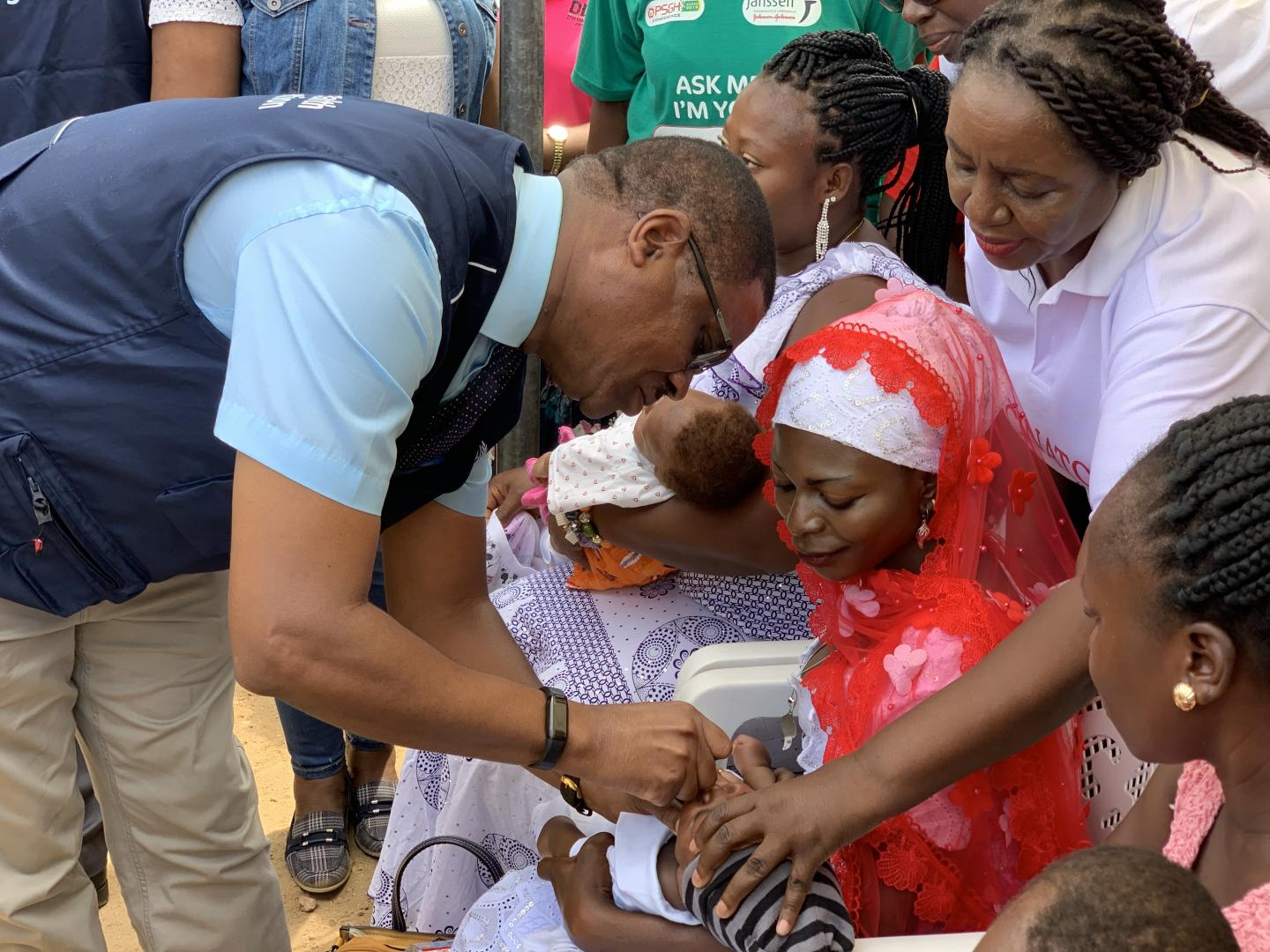 Country Representative of WHO, Dr Owen Kaluwa vaccinating a baby
