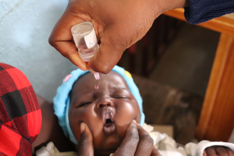 Lilosa Muti's 6-week-old baby, Joshua, getting vaccinated at Bikita Rural Hospital, Zimbabwe. 2020 ©WHO/Tatenda Chimbwanda