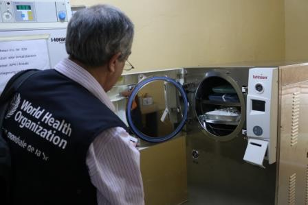 Dr. Peter Hoffman inspects autoclave at a local hospital in Monrovia