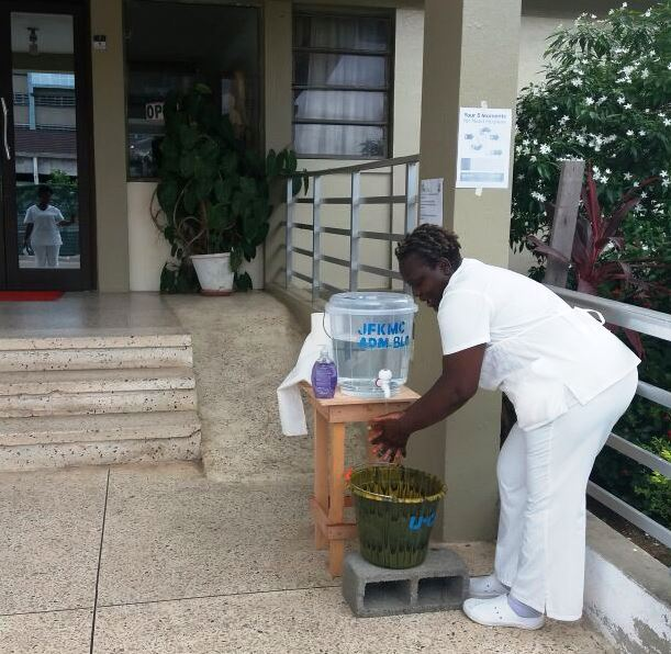 A Professional Nurse at the JFK  Medical Center demonstrating proper hand hygiene during the WHHD in Monrovia