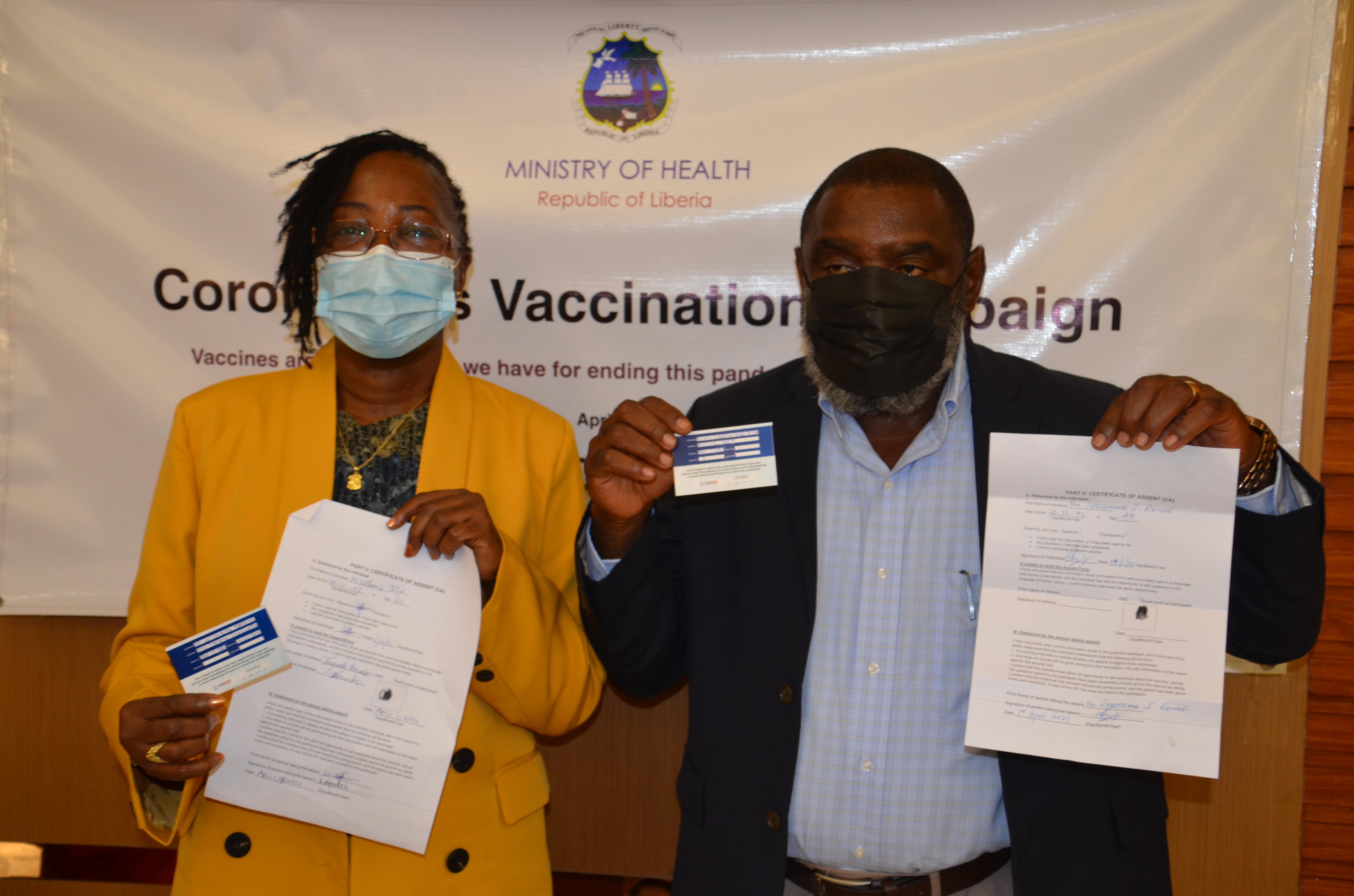Health Minister Dr. W.Jallah and Information Minister after receiving COVID-19 Vaccine