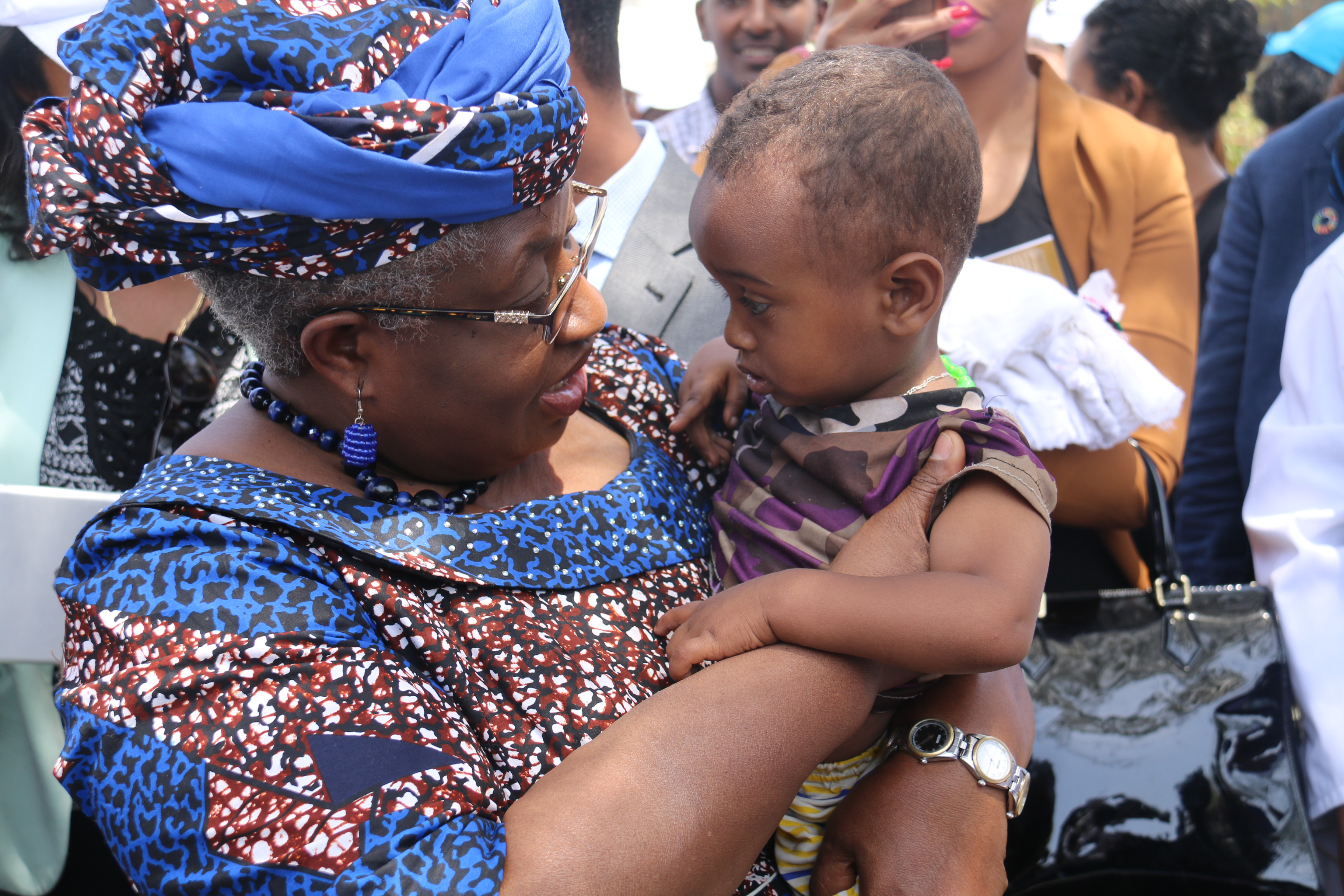 Dr Ngozi Okonjo-Iweala, Gavi Board Chair,with a child vaccinated measles second dose during the launching