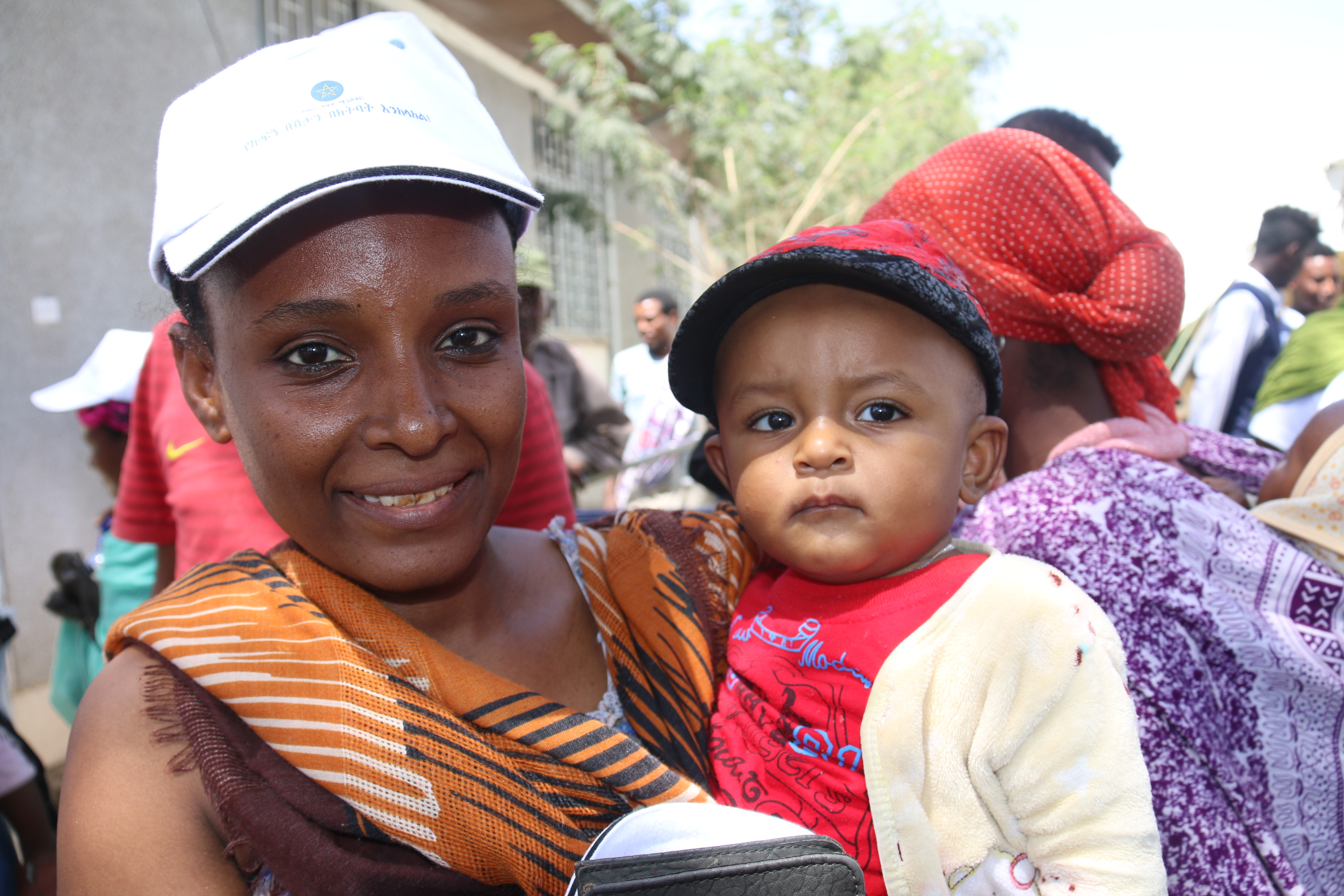 Mother with her child who have been vaccinated measles second dose during the launching