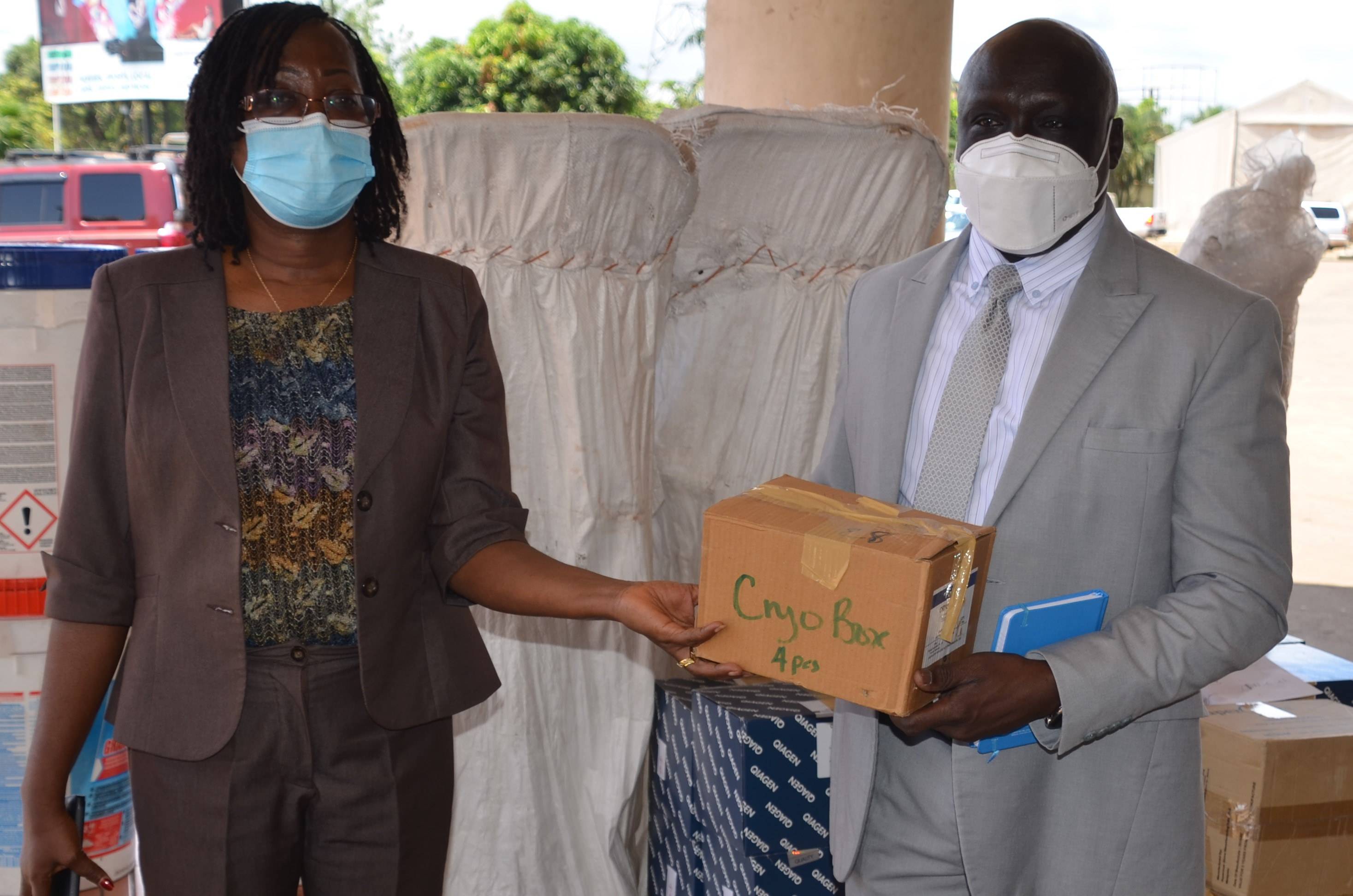 Dr. Peter Clement, WR-Liberia handing over donated supplies to the Honorable Minister of Health Dr. Wilhelmina Jallah