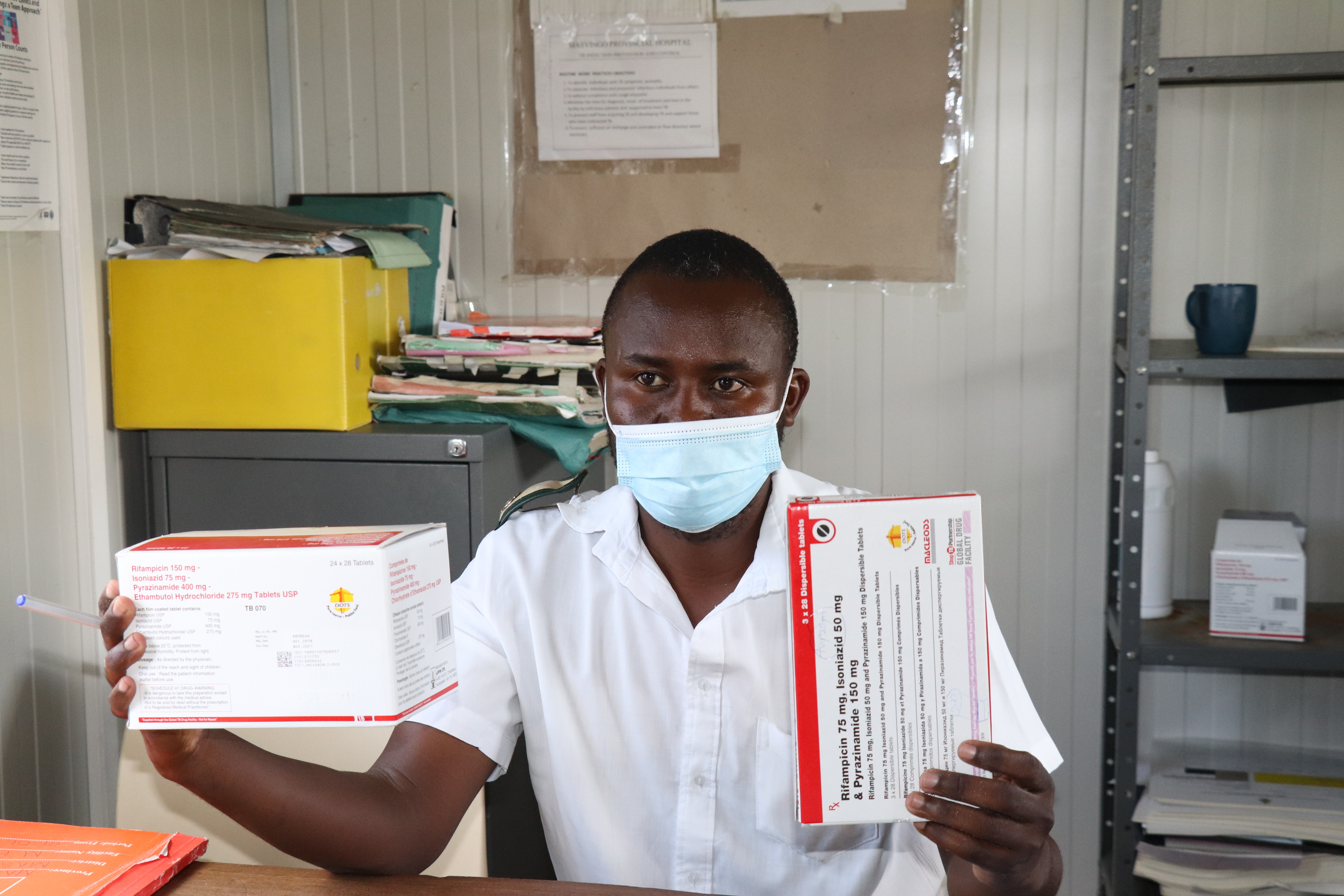 Health Care Worker Holding TB Drugs