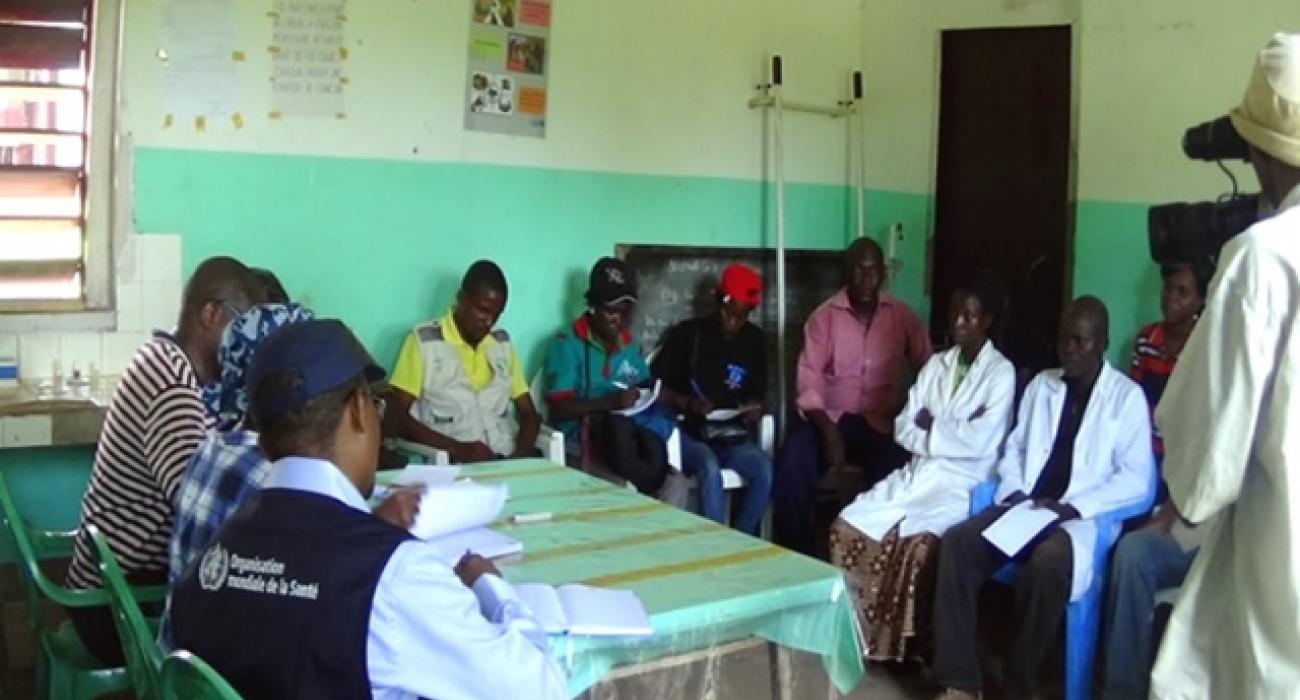 WHO and Ministry of Health staff discussing with nurses