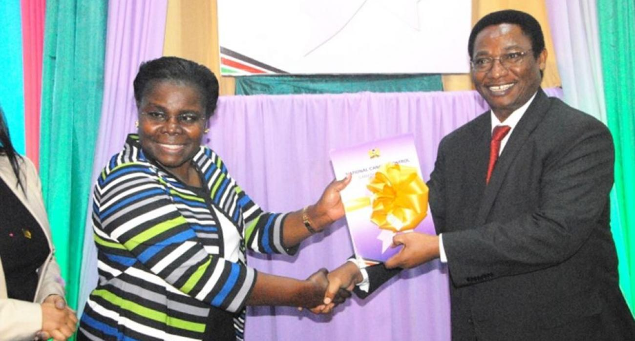 WHO Officer, Dr Joyce Nato receives the launched strategy document from DMS Dr Jackson Kioko
