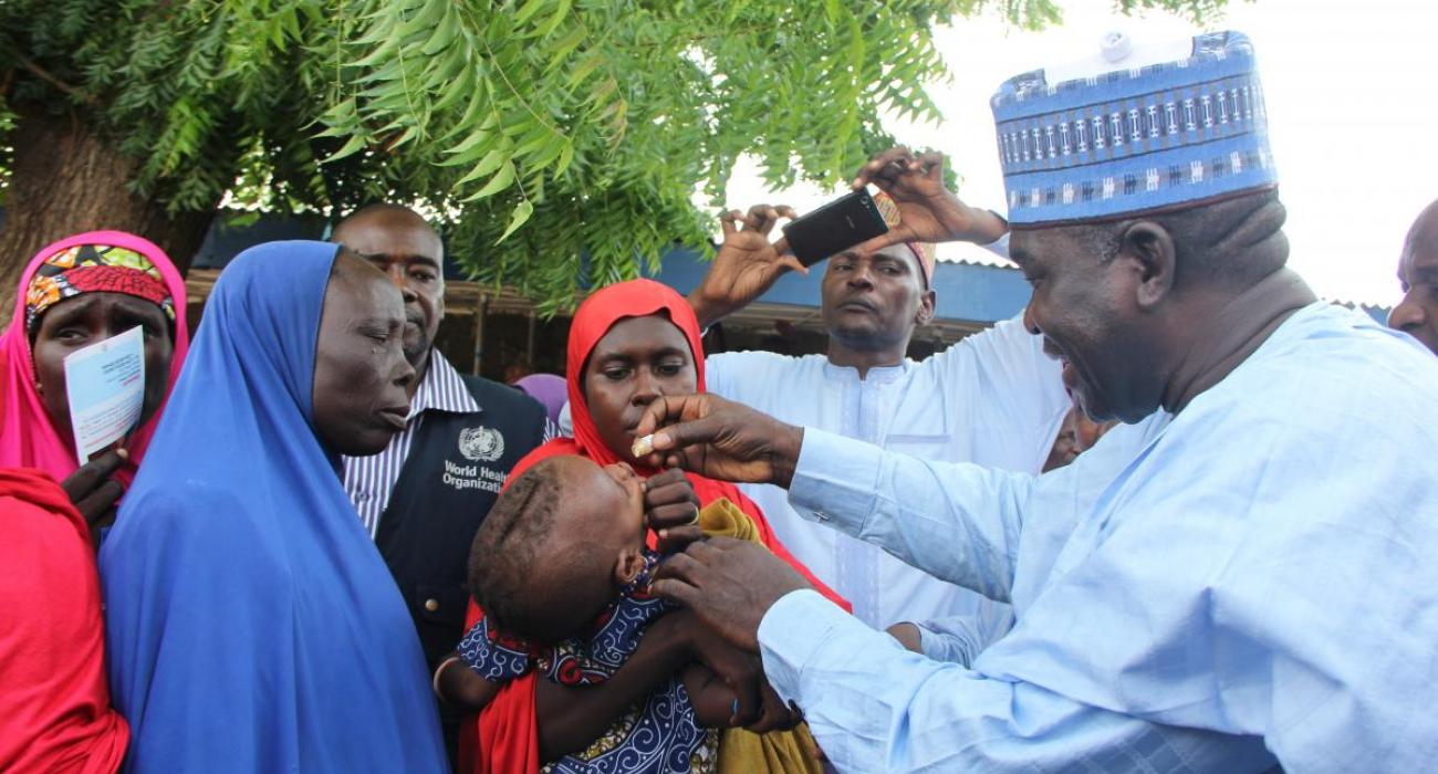 Head of Service,  vaccinating a child with oral cholera vaccine at Muna IDPs camp in Borno state.