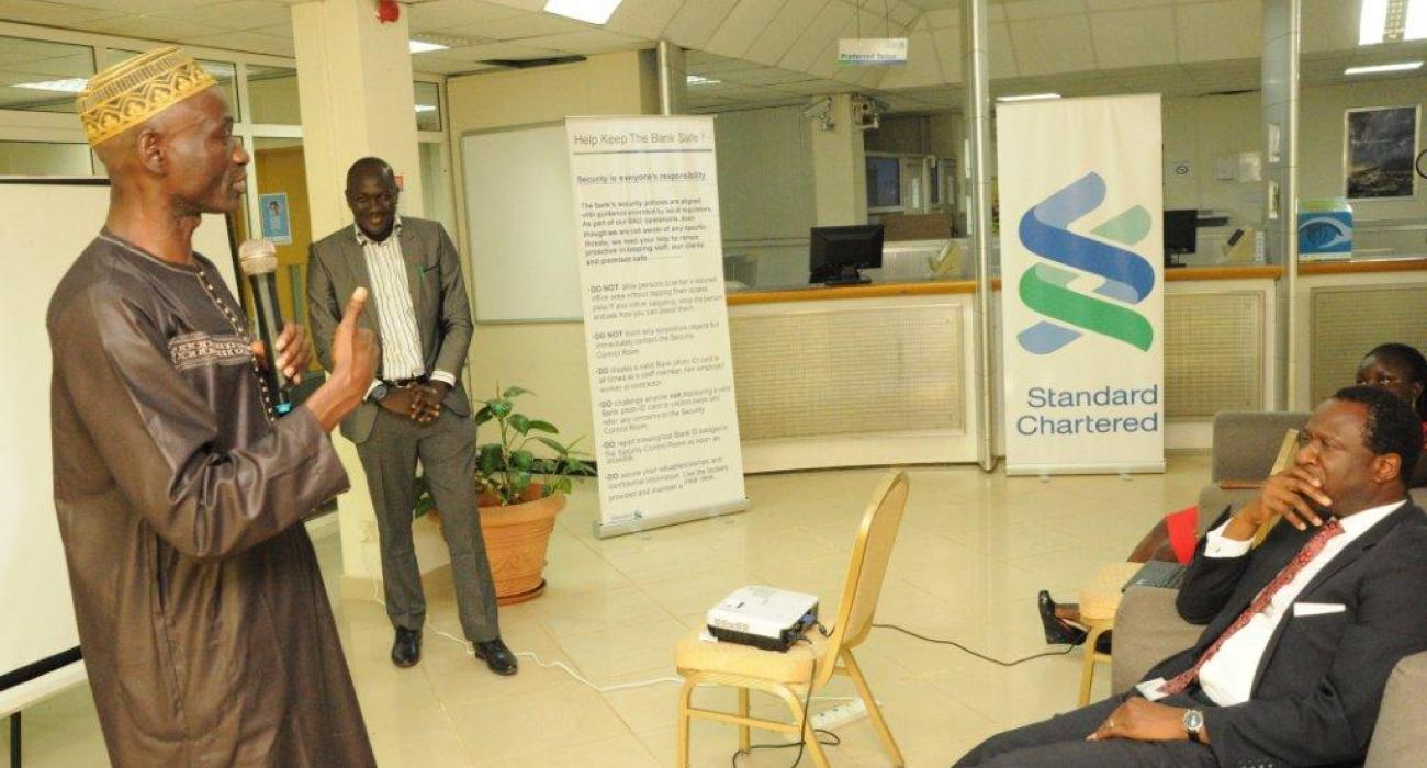 Mr Momodou Gassama (WHO) presenting on stress management in            workplaces for officials of Standard Chartered Bank  Gambia Ltd.