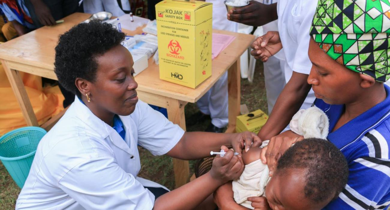 The Minister of Health, Dr Diane Gashumba, providing Measles and Rubella Vaccine