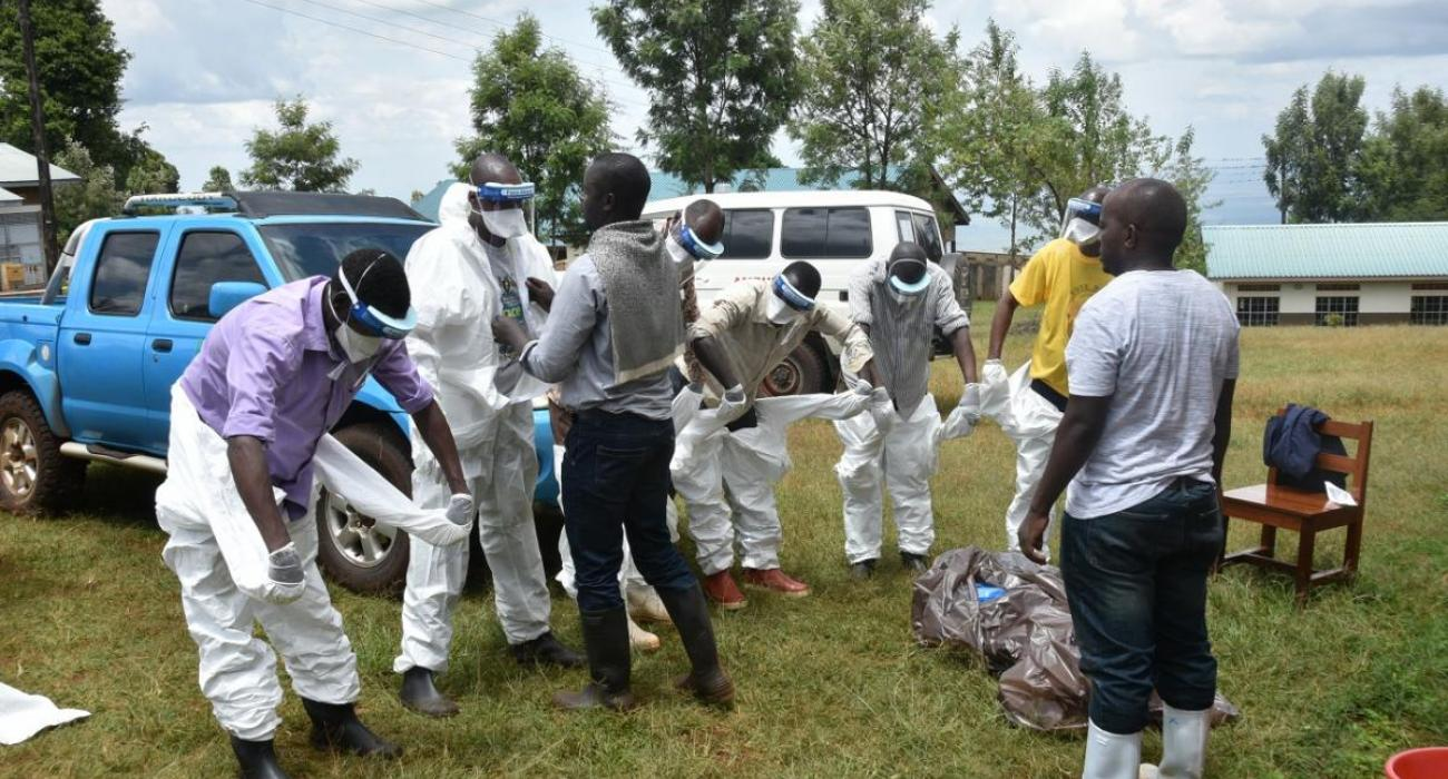 Health workers don their Personal protective Equipment
