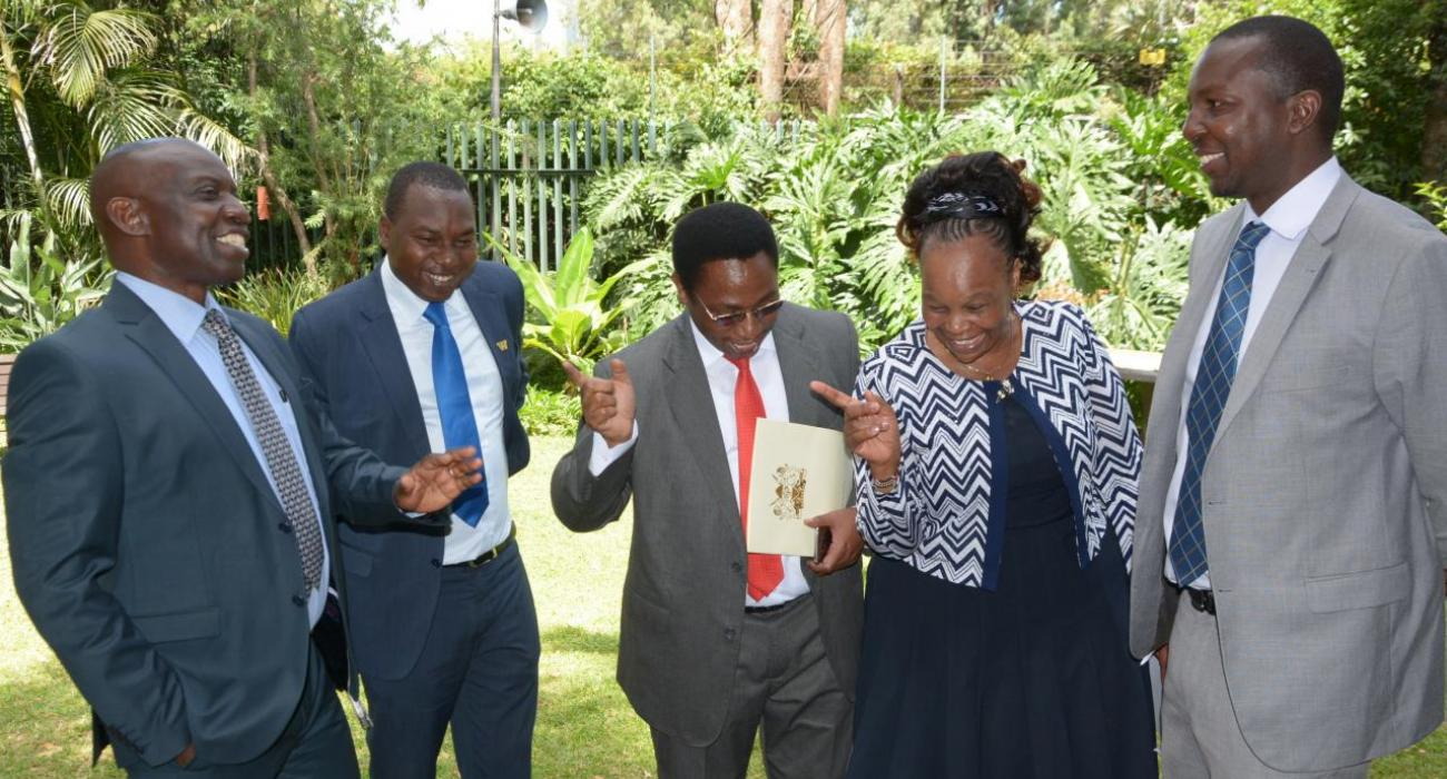 An elated Director of Medical Services Dr Jackson Kioko (centre) and team respond to the news ' Kenya meets the GW Certification criteria' and closer to GW-free status. From left: Drs. John Ogange (WHO), Dr Peter Cherutich (MOH), Dr Joyce Onsongo (DPC, WHO) and Dr Sam Mahugu (MOH)