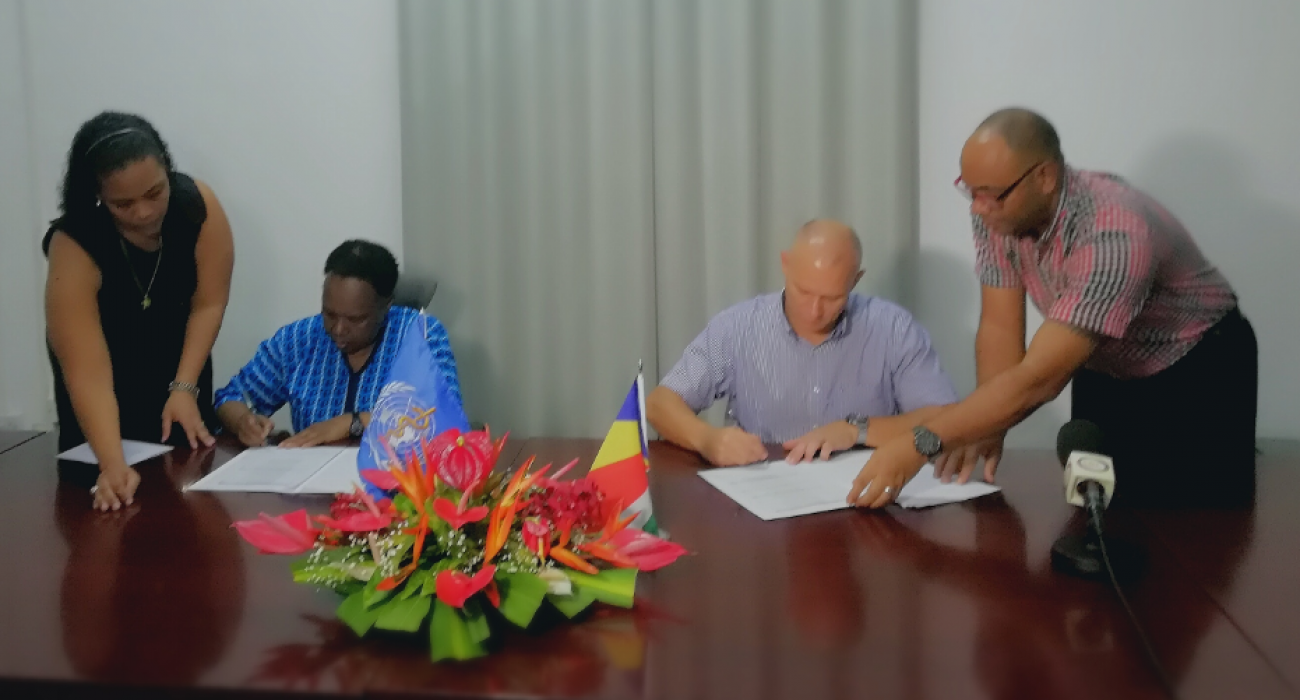 Dr Teniin Gakuruh, acting WHO Liaison Officer and Honorable Jean Paul Adam, Minister of Health signs the framework