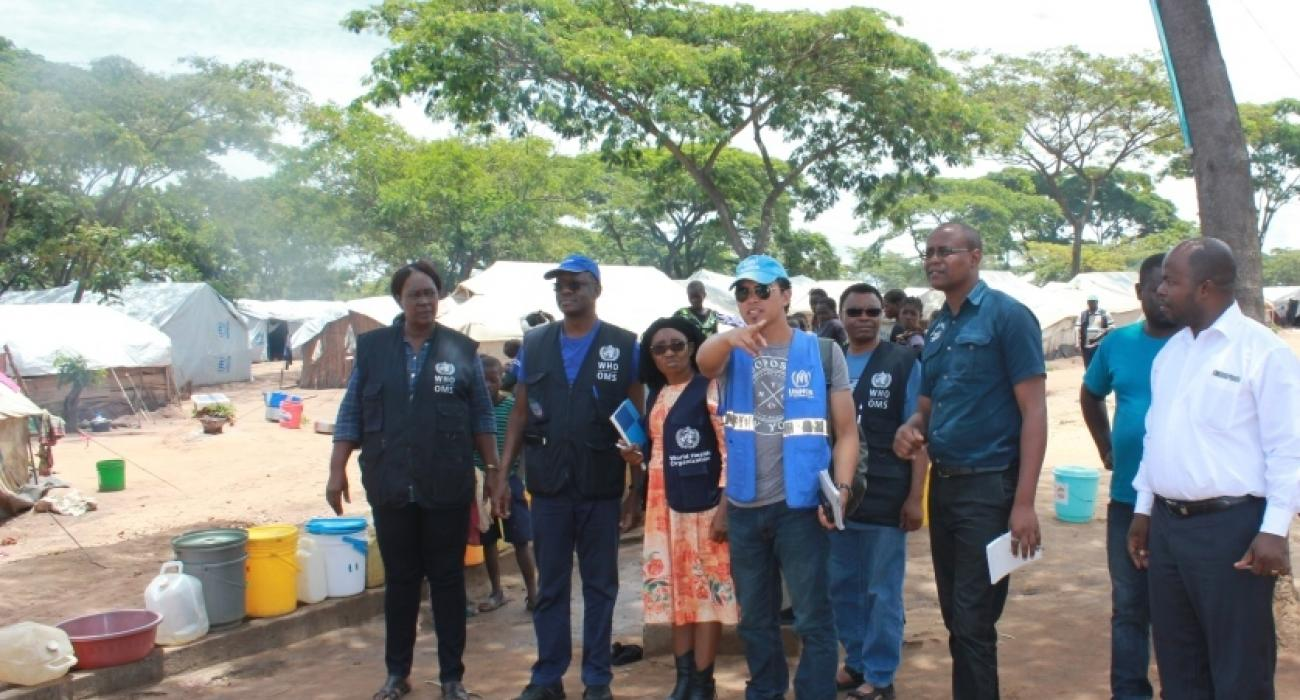 The WHO Representative, Dr. Nathan Bakyaita  (second from left), accompanied by WHO National Surveillance Officers and the Disease Prevention and Control Officer on a conducted tour of Mantampala Refugee Camp