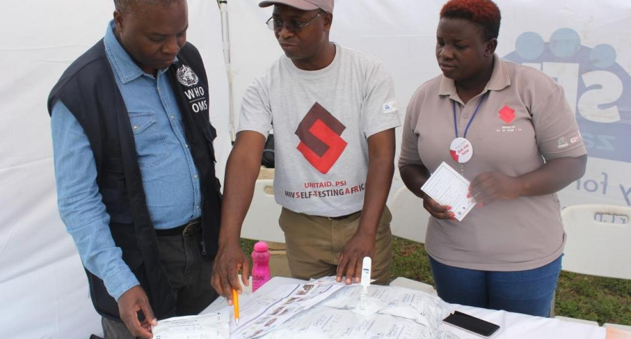 Dr. Lastone Chitembo, HIV/AIDS/TB Advisor at WHO visiting the Society for Family Health exhibition stand where HIV self testing was promoted.