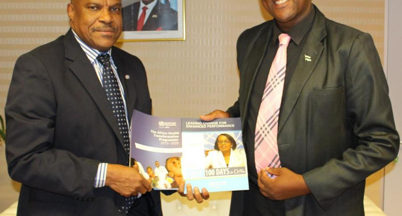 Hon Dr Alfred Madigele, new Minister of Health and Wellness (left) receiving documents from Dr M Ovberedjo, WHO Representative