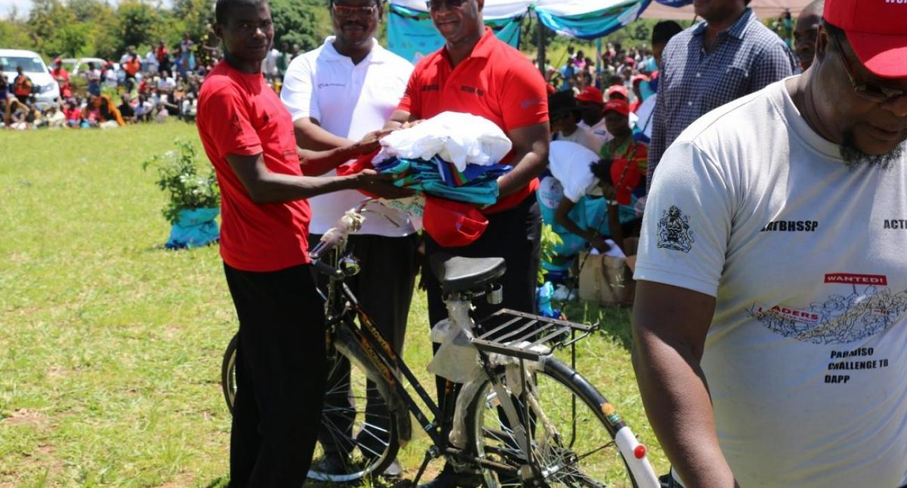 The Honorable Minister of Health Honorable Atupele Muluzi, MP handed over bicylces, World TB Day T-Shirts and cloth to members of best performing Community Sputum Collection Centres in Salima