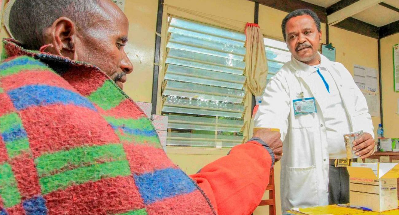 A health worker gives medication to a patient.  Kenya has embarked on a extensive evidence-based approach to root out TB