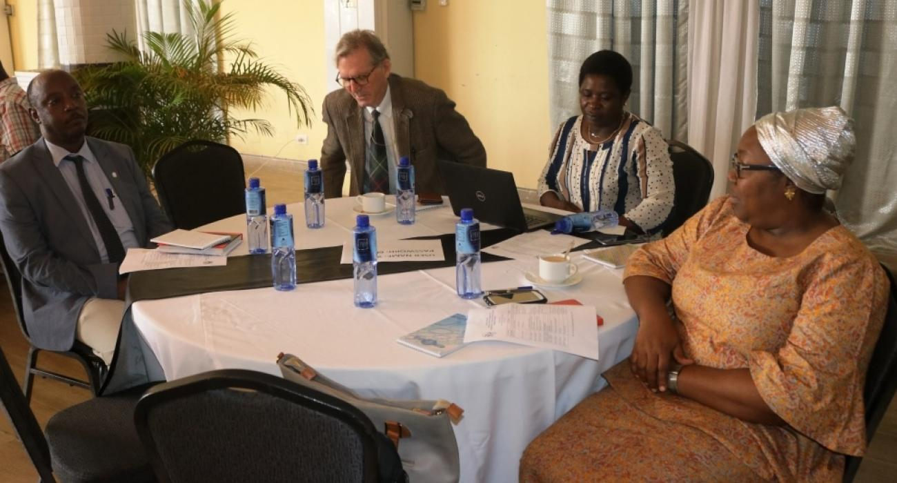 (L-R) Dr. Alex Gasasira (WHO), Dr. Charles W. Oliver (USAID), Mrs. Ellen Munemo (ACCEL) and Assistant Health Minister Dr. Catherine cooper at the validation workshop