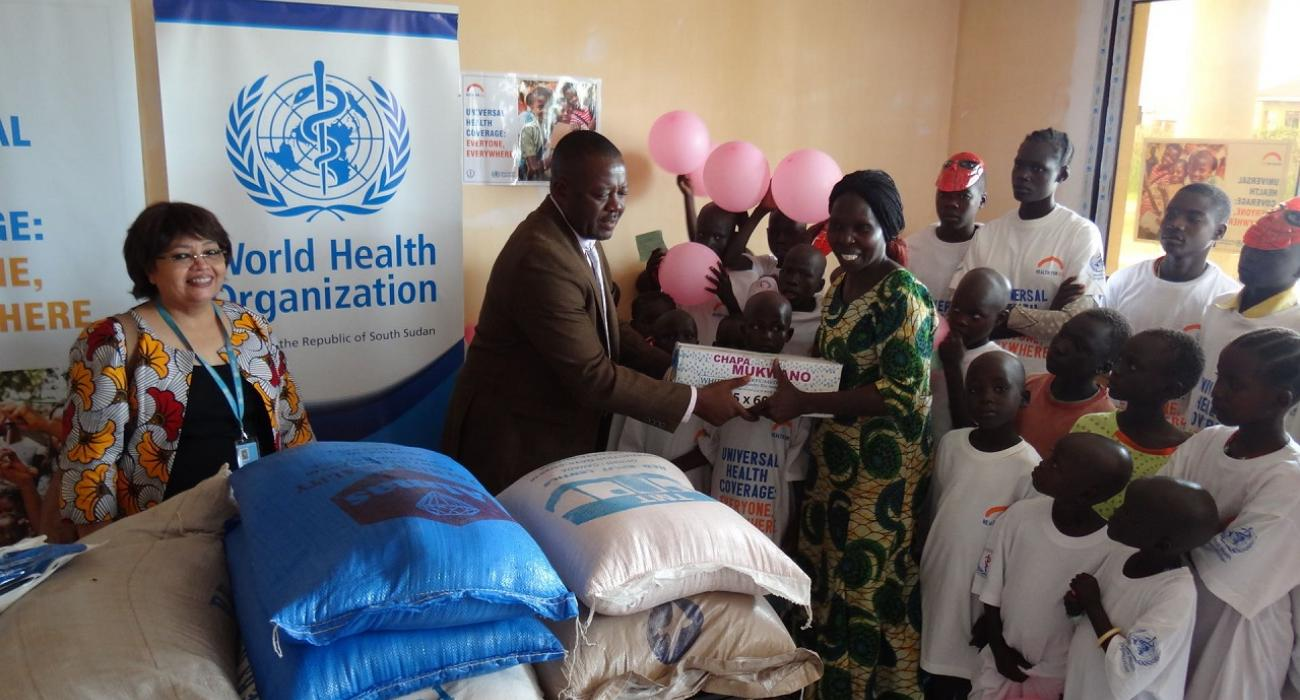 Mr Liyosi Evans handing over assorted items and chemical free water filters to the orphanage home