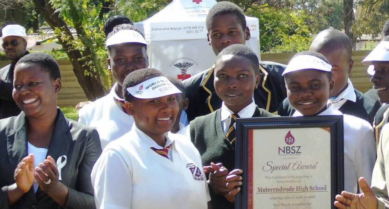 Students from the winning school pose with their award