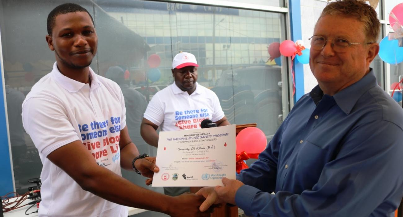 The University of Liberia voluntary Blood Donor group receives certificate of appreciation for  donating the highest amount of blood over time