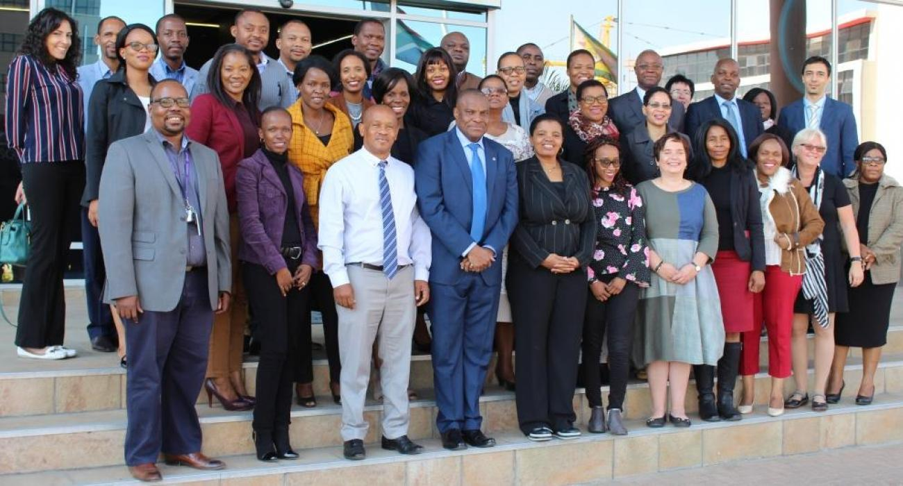Pharmacovigilance workshop particpants with Dr Ovberedjo (WHO Representative - front row in blue suit) and Dr Seipone (Deputy PS in Min of Health & Wellness - left of WHO Rep, in stripped jacket)