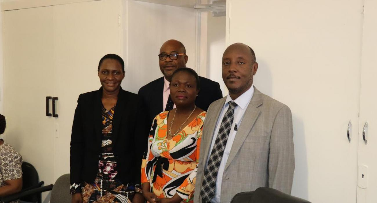 Dr Gasasira with Mrs Gore Staff Association President, MR Avognon, OO and Dr Nabyonga former OIC