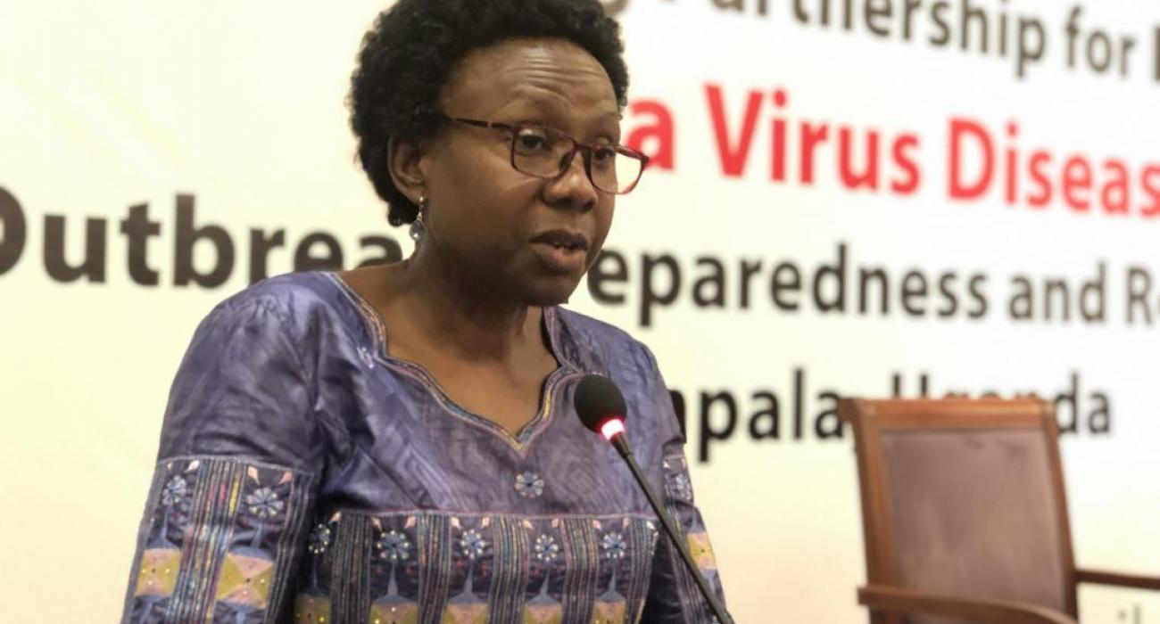 Minister of Health, Dr Jane Ruth Aceng addresses the congregation during the International Partners meeting to Discuss Ebola Preparedness and Response