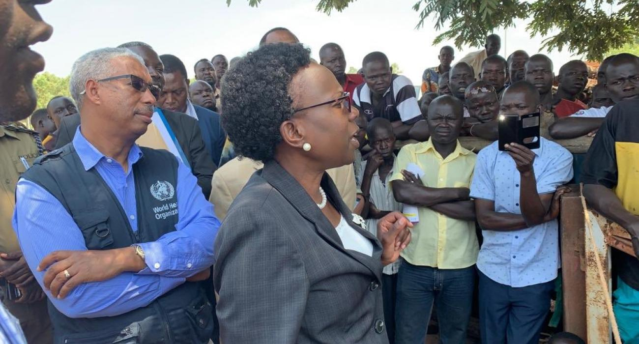 Minister of Health Dr Jane Ruth Aceng (black suit) addresses a gathering in Arua district about Ebola Virus Disease. Looking on is the WHO Representative in Uganda, Dr Yonas Tegegn Woldemariam (WHO branded jacket)