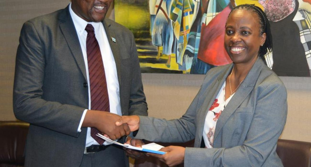 Dr Josephine Namboze, WHO Representative (right) presenting her credentials to the Minister of Health and Wellness, Honourable Dr Alfred Madigele