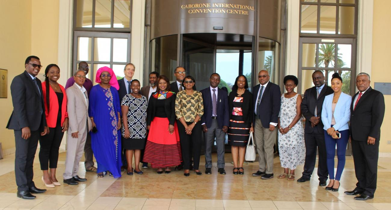 The WHO Regional Director for AFRICA, Dr M Moeti (centre, front row), with participants and facilitators at the AACHRD meeting