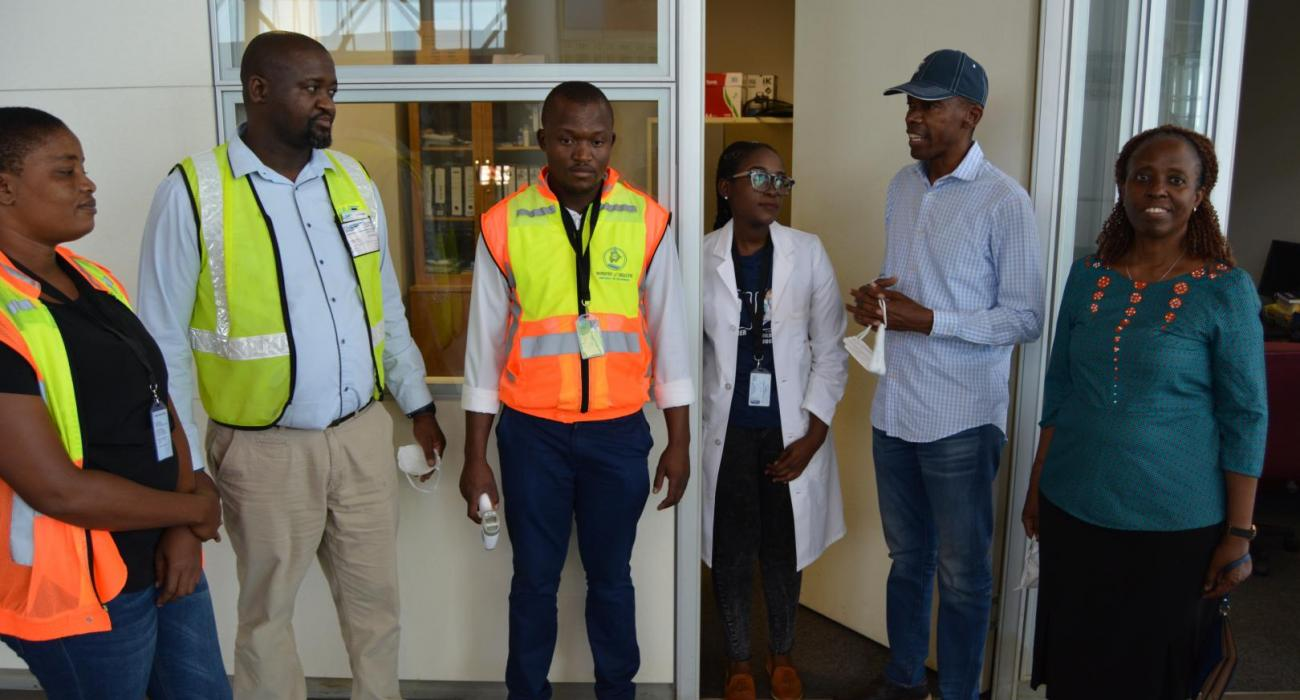 The Minister (2nd from right) and WR (far right) discussing with Port Health Officers and Airport Staff