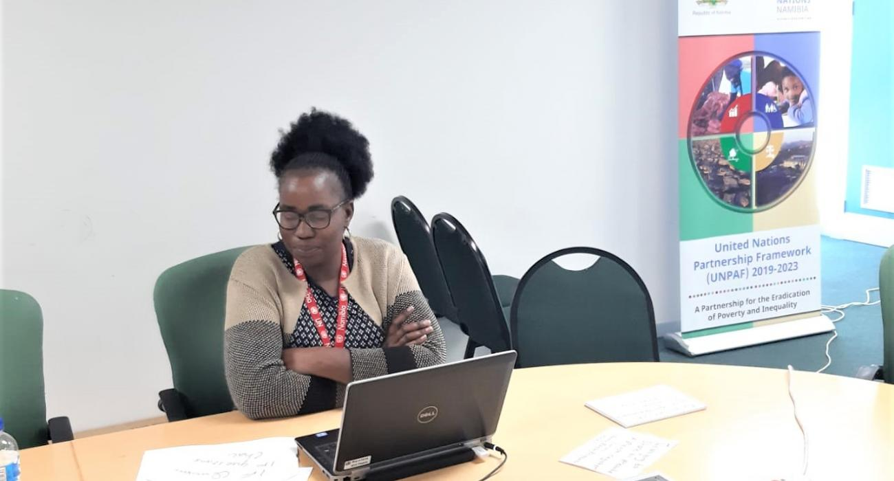 Ms Ndilimeke Mutikisha  proving online training to surveillance officers on COVID-19