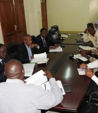 Dr. Kamwa receiving a briefing from Ministry of Health Staff on impelementation of the International Health Regulations