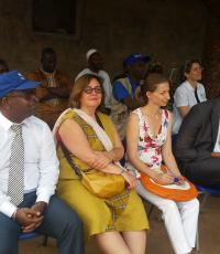 Prof. JM Dangou (l - row 1) with other dignitaries in a community setting to assess tools distributed by partners in support of malaria prevention