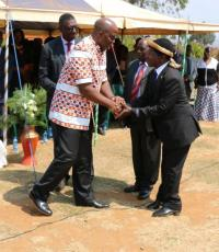 The Group Village Headman Kamenyagwaza (left) bids farewell to the Honorable Minister Mr Atupele Muluzi, MP, after the launch ceremony of the National Alcohol Policy