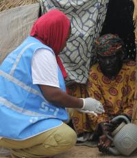 Field volunteer conducting orientation on hand washing/household hygiene. WHO/CE.Onuekwe