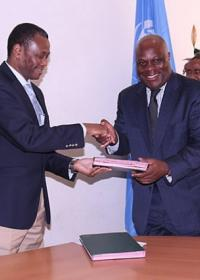 The WHO Representative, Dr. Rufaro Chatora and the Permanent Secretary, Dr. Donan Mmbando exchanging the certificates of transfer.