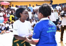 Rwanda Biomedical Centre Director General, Dr. Jeanine Condo congratulating a former TB patient after testimony