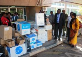 Dr. Mary Katepa Bwalya, OIC at WHO handing over the medical supplies to the Minister of Health, Dr. Chitalu Chilufya (left) in the presence of Dr. Victor Mukonka, Director at the National Public Health Institute