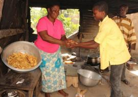 Madam Kamazoue Abatan, food vendor. She is a beneficiary of early diagnosis and prompt treatment.