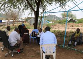 Kifa Bashir (center) in a discussion with the community leaders in Babile Woreda. Photo: WHO/Tseday Zerayacob