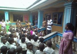 WHO LGA Facilitator  in sensitization meeting with teachers and pupils in a Yenagoa Primary school